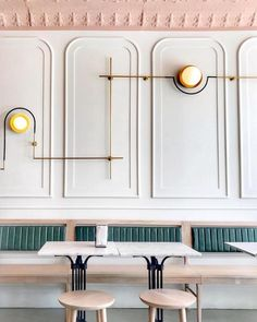 My 10 Favorite Ways to Create Feature Walls - Interior Design Tips by Nadine Stay. Reverse picture frame wainscoting in a restaurant. Photo by Girls Just Know.