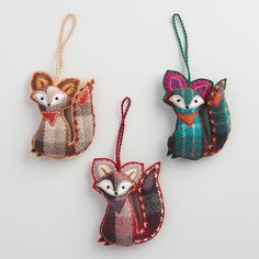 Handmade of fabric by artisans in India, our set of three fox ornaments feature bold plaid designs of tan, teal and purple checkers. Each fox is adorned with fine embroidery and vibrant details along its ears, tail and bandana.