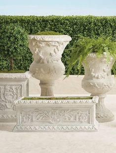 Inspired by the romantic grandeur of historical Provencal gardens, our eye-catching, all-weather planters feature gorgeously detailed designs including botanical motifs, ribbon laurels and artfully molded rims. The sturdy pulverized stone and polyresin construction ensures it will be a staple for showcasing flowers, grasses and topiaries for years to come. Boxwood Topiary, Topiaries, Trough Planters, Garden Planters, Red Poppies, Red Flowers, Furniture Placement, Grasses, Planter Boxes
