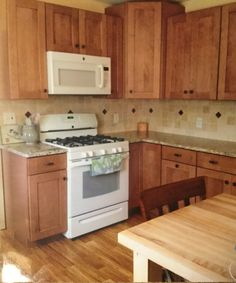 Remodeled kitchen-Santa Cecelia granite, tile backsplash with accents