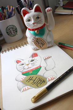Maneki-neko.The China cat that brings good luck into your home!