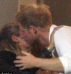The birthday boy - who flew back to London by helicopter for the celebration - kisses a blonde haired guest, not Cressida Bonas