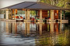 "Great Shot of a ""Woody Boathouse"" at a Muskoka Island Retreat! Boat Garage, Lake Dock, Boat Dock, Lakefront Property, Architecture Interiors, Wooden Boats, Great Shots, Water Crafts, Rustic Design"