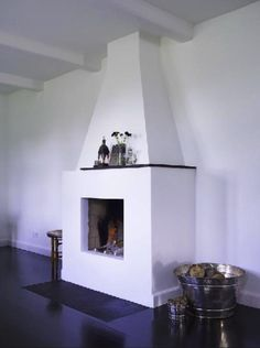 ebony floors white fireplace from The Most Beautiful House in Denmark : Remodelista