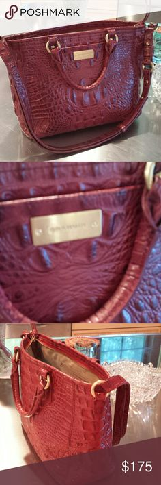 Brahmin bag Beautiful Brahmin bag deep rich red color clean on the inside light very light wear on the corner has a zip closure two zip pockets on the inside two regular pockets , one key fob two pen holders, one outside pocket has the regular handbag handles and also the shoulder strap  beautiful condition measurement across the top is approximately 12 inches the height is 8.5 and the depth is approximately 4 inches Brahmin  Bags Shoulder Bags