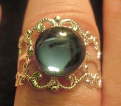 Victorian Style Silver Adjustable Filigree Ring with Montana Blue Glass Cabochon $10.00