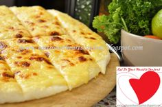 CAVITE'S SOUK KAFE    Mana is their own brand of heavenly pizza bread which is cooked the moment you order it. What you get is freshly prepared soft baked flat bread covered with a generous spread of melted cheese.