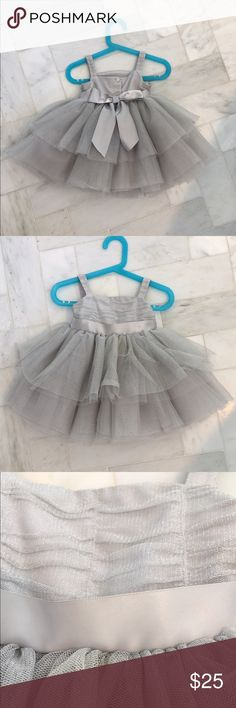 Silver tulle party bow dress Janie and Jack 6-12mo So chic! Minor snags in the tulle from wearing it once, see pic.  Ruched in the front and a pretty satin bow in the back! Janie and Jack Dresses Formal