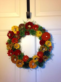 Are you ready for Fall? This unique Pine Cone Wreath will take you right there. Tons of color mimic one of the most beautiful seasons bringing you that warm cozy feeling. This wreath is 13.5 x 13.5 in diameter and is wired enabling it to be used outside, preferably under a covered porch. Cones are hand painted and sprayed with an acrylic coating.