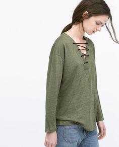 Shirt met touwtjes decollete