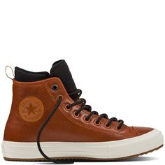The Converse Chuck Taylor All Star II Boot defies the elements with a water-resistant upper and inner sleeve. Other features include a Nike Lunarlon insole for cushioning, a water-resistant inner sleeve that helps keep out rain, a rugged rubber outsole for superb traction, and a Neoprene collar that enhances warmth and comfort. Hi LEATHER