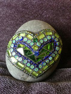 I used glass, millefiori,beads and jewels in this green mosaic rock of love. It is grouted and waterproof. The rock is The rock is a Mosaic Crafts, Mosaic Projects, Mosaic Art, Mosaic Glass, Mosaic Tiles, Glass Art, Stained Glass, Mosaic Mirrors, Sea Glass
