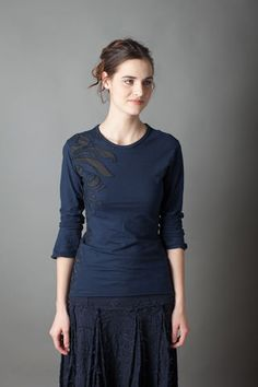 "This 100% organic lightweight cotton-jersey fitted T-shirt features our Magdalena stencil, sewn in placement fashion using backstitich reverse appliqué. Measures 26"" from shoulder. Shown here in Navy with Black. Bottom layer comes in Black. Choose your top layer color and sleeve length below. Please allow four to six weeks for delivery. Wash gently + Hang to dry. Free domestic shipping. Made in the USA."