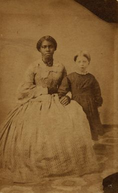 Frances (a slave) and Sally Smith, from mohistory.org.  Description: Robert B. Smith, a farmer in Lexington, Missouri, enslaved six people in 1860.  One of the Smith's identified slaves, Frances is written on the back of this photograph.
