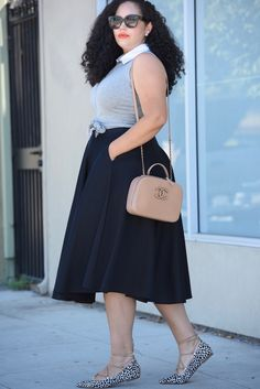 Tanesha Awasthi, also known as Girl With Curves, wearing a tie-waist crop top, black midi skirt, animal print lace-up flats and Chanel bag.