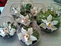 Orchids and succulents in a fish bowl. Would need to add other height vases.