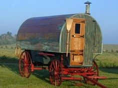 "Restoration by: Hansen Wheel & Wagon Shop ~ Distressed Copper Top Sheep Wagon: ""This restoration was built to have an aged appearance. The copper roof was treated with an acid etched finish. This also helps to weatherproof the wagon top. The interior of the roof is lined with canvas for a brighter look. Inside there is an original sheep herder's stove and oven to cook biscuits. The cabinets are all oak and the walls have pine wainscoting."" (pinning detailed pics of inside marked w/ number 5)"