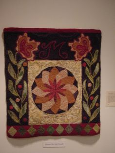 Fraktur inspired rug at Susan Feller exhibit held at Mennonite Heritage Center in PA several years ago.  Not sure who hooked it.