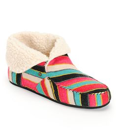 Keep your feet toasty in the comfy Volcom Girls Good Spirits multi stripe slippers. Instantly feel the warmth of the foldable white Sherpa lined collar and footbed, exposed stitching Moc style toe, multi stripe suede colorway, small Volcom Stone badge at