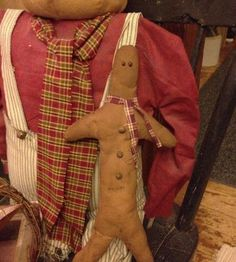 I made this primitive skinny gingerbread man out of muslin, color washed, scarf. He measures 12 inches tall.