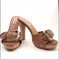 Steve Madden Crunk Adorable tan Steve Madden Crunk slide mule with 1/2 inch platform and wooden heel. Genuine tan leather upper with gold rivets and buckle.   Very good used condition. 275 Steve Madden Shoes Heels