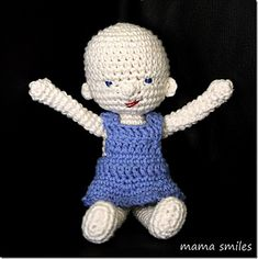 Pattern for a small (roughly 9 inch) crocheted baby doll, as well as a dress for the doll to wear.