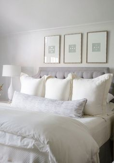Bedroom decor ideas - all white, light & bright, classic tufted grey headboard with white on white bedding, soft neutral artwork hung above bed.