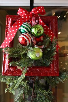 Wouldn't this look cute on your door? Minus the evergreen that is!