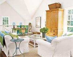 nice white with blues and greens...also love the little desk off to the side for a laptop or work table
