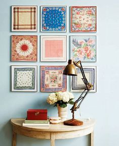Interesting idea--quilts as wall art. small pieces as a mosaic. what about one large piece framed? nice alternative to wallpaper. perhaps merrimeko fabric?