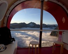 View from Refuge Gervasutti, a sleeping tube for climbers in the Alps. The tube cantilevers over the side of a mountain: thus the spectacular view. Designed by LEAPfactory.