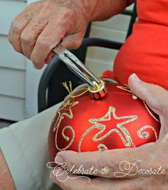 She removes an ornament top and watch what happens when it pops off... gorgeous front porch idea!