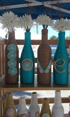 Upcycled Rope wrapped Wine Bottles as a wedding Decor. These adorable rope wrapped wine bottles with the letters to spell LOVE are wonderful for a wedding with flowers in. Wine Bottle Art, Diy Bottle, Wine Bottle Crafts, Rope Crafts, Jar Crafts, Garrafa Diy, Wrapped Wine Bottles, Twine Bottles, Bottle Candles