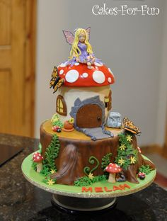 Mushroom and tree stump are cake, all decorating is with...