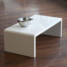 white coffee table- not sure if this would be client approved because not totally round edges, but simple, clean and modern, would work with the look