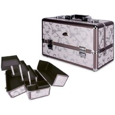 "15 inch Dual tone Bronze Floral Pattern 3 Extendable Trays Aluminum Professional Makeup Artist Cosmetic Travel Carrying Train Case Storage Organizer + Brush Holder + Shoulder Strap by Sunrise. $52.50. Features a traditional-style flower design aluminum finish bordered by aluminum trimming.. The sturdy aluminum frame and the heat-resistant exterior material help protect your cosmetics from damage.. Overall Dimensions - 15"" L X 8"" W X 9.25"" H; Each Tray - 10"" L X 5"" W X 1"" H; C..."