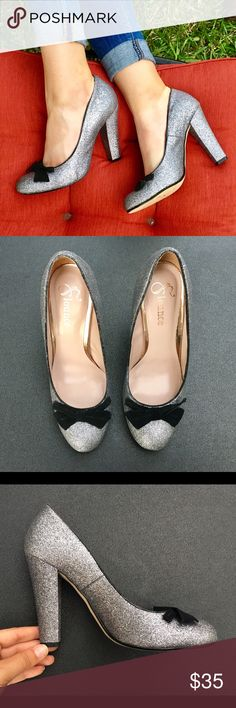 Flounce Silver Glitter Bow Heel Do these shoes scream New Years Eve or what?! This absolutely stunning and charming pair of heels by Flounce are in excellent pre-worn condition---almost like new! Flounce Shoes Heels