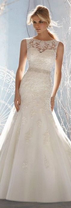 Beautiful, lace, crystal beaded, mermaid style, wedding dress with beaded belt at natural waist.