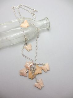 Peach Butterflies. Carved quartz butterflies clustered on long adjustable necklace; Spring and summer accessories