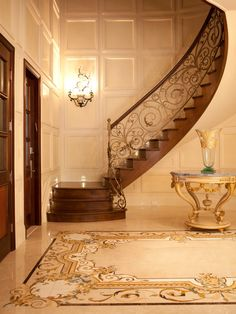 Entry - gorgeous French wrought iron stair railing, floors