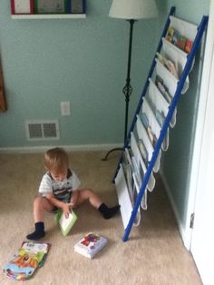 A bookshelf I made for Joshs room from the removed side of the Ikea crib that converted to his toddler bed.