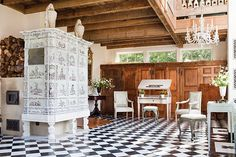 """A rococo tile stove from Switzerland dominates the studio of landscape architects Barbara Paca and Philip Logan of Preservation Green.  European tile stoves produce a large amount of radiant heat, and their simplicity and efficiency are being rediscovered and implemented in American homes.""  - Dering Hall Swedish Interiors, Stove Fireplace, Radiant Heat, Swedish Design, Beautiful Space, Rococo, Wood Stoves, Landscape Architects, Patio"