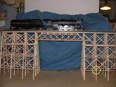 This bridge has been constructed with little bits of wood. It is so well constructed it can hold A VERY HEAVY model train. The better that is made the more weight that it can hold