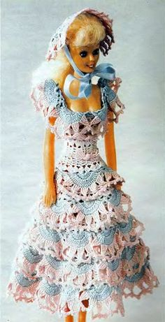 This reminds me of the dress my mother made me for my small doll like this.  It was a crocheted red and white dress; I don't remember a hat.  I used to have the dress but it has long disappeared.