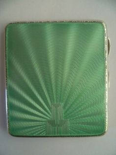 Mint Green Art Deco Enamel Cigarette Case, Circa 1934: THE SOLID SILVER CIGARETTE CASE IS HALLMARKED BIRMINGHAM WITH THE DATE MARK FOR 1934,WITH THE MAKERS MARK FOR WILLIAM NEALE & SON Ltd THE CASE MEASURES 3.25ins (8.3cms) IN LENGTH AND 2.75ins  (7.cms) IN WIDTH.