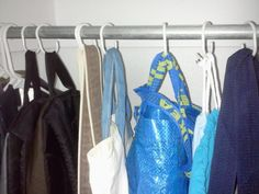 The hooks take up less space than hangers. And it's a great way to compartmentalize the things in your closet that don't have a place — scarves, belts, socks.