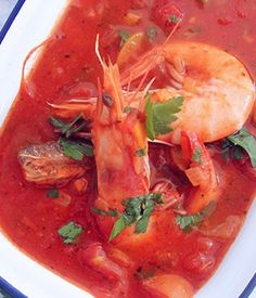 This gorgeous fish stew is a bowl of sunshine deliciously enhanced with sweet Rosanna onions. Serve with some warm bread on a cold day for an instant pick-me-up.
