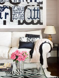 love this...love the typographic artwork and the whole graphic contrast of the room with just a touch of pink to soften...