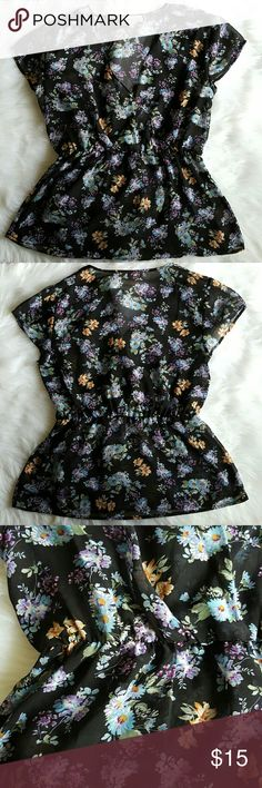 Philosophy sheer floral wrap blouse Medium Medium sheer blouse in black with blue, gold and purple flowers. Elastic waist and faux wrap V-neck. Excellent used condition. Philosophy Tops Blouses