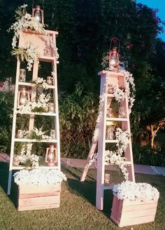 Enhancing the bar with some pretty white flowers arranged on a step ladder with lanterns